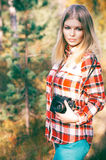 Young Woman walking with retro photo camera outdoor Lifestyle Royalty Free Stock Image