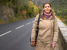 Young woman walking on a road Stock Photos