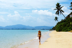 Young woman walking on a sandy beach of Thailand Stock Image