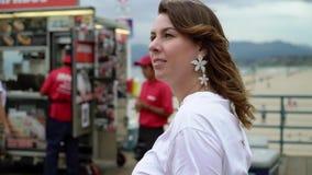 Young woman walking at Santa Monica pier stock footage