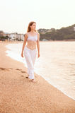 Young woman walking Royalty Free Stock Photography