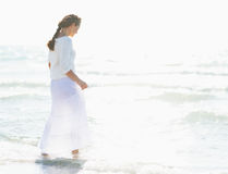 Young woman walking into sea Royalty Free Stock Image