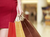 Young woman walking with shopping bags in mall Stock Images
