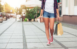 Young woman walking and shopping in the city Stock Images