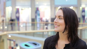 Young Woman Walking Through Shopping Mall stock footage