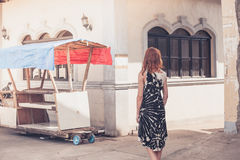 Young woman walking in a small town in developing country Royalty Free Stock Image