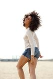 Young woman walking and smiling outdoors Royalty Free Stock Image