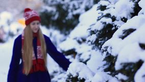 Young woman walking in snow forest stock video