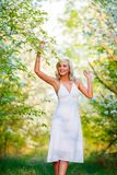 Young woman walking in the spring garden Royalty Free Stock Image
