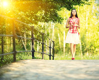 Young woman walking in spring park. Royalty Free Stock Image