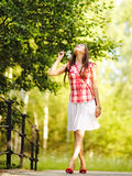 Young woman walking in spring park. Stock Photography