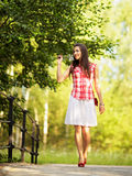 Young woman walking in spring park. Royalty Free Stock Photography