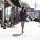 Young woman walking on the street Royalty Free Stock Photography