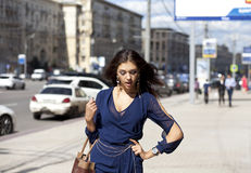 Young woman walking on the street Stock Photography