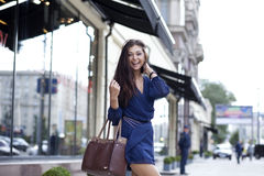 Young woman walking on the street Stock Image