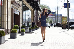 Young woman walking on the street stock photo