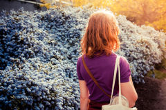Young woman walking in the street on a sunny day Stock Photography