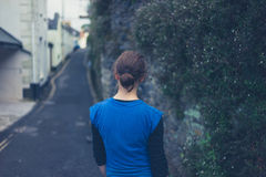 Young woman walking in street of village Royalty Free Stock Image