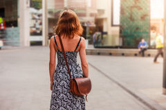 Young woman walking in the street Stock Photo
