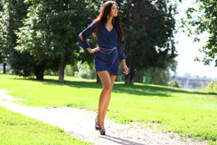 young woman walking on the summer park royalty free stock image
