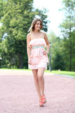 Young woman walking on the summer park Stock Image