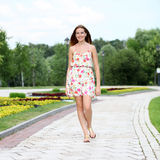 Young woman walking on the summer park Royalty Free Stock Photos