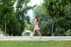 young woman walking on the summer park Stock Photos