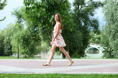 young woman walking on the summer park Royalty Free Stock Images