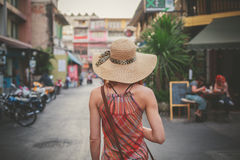 Young woman walking on th estreet in asian country stock photos