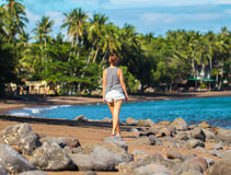 Young woman walking on tropical beach. Summer vacation casual photo Royalty Free Stock Photo