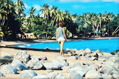 Young woman walking on tropical beach. Summer vacation digital illustration. Stock Photography
