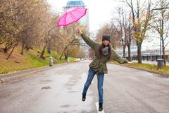 Young woman walking with umbrella in autumn rainy. Day. This image has attached release Stock Image