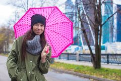 Young woman walking with umbrella in autumn rainy Stock Photo