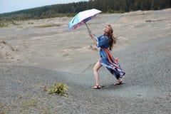 Young Woman Walking with umbrella. Indian style Beautiful Girl. Raining day Stock Photo