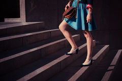Young woman walking up stairs Royalty Free Stock Photography