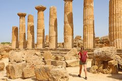 Young woman walking in the Valley of the Temples Agrigento, Sicily. Traveler girl visits Greek Temples in Southern Italy stock photos