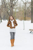 Young woman walking in winter park Stock Images