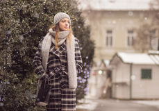 Young woman walking winter snow snowing Stock Image