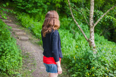 Young woman walking in the woods Royalty Free Stock Photos