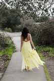 Young Woman Walking in Yellow Dress Outdoors Royalty Free Stock Photos