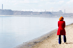 Young woman walks alone on a beach Royalty Free Stock Photography