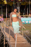 A young woman walks along the footbridge. A young woman walking along the lanes in turquoise clothes Royalty Free Stock Images