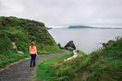 Young woman walks along pathway surrounded by irish landscape stock photos