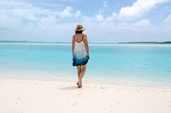Young woman walks barfoot on deserted tropical island Royalty Free Stock Photos