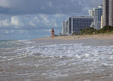 Young woman walks Miami Beach in the morning Royalty Free Stock Images
