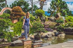 A young woman walks the rocks across the river Stock Photography