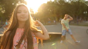 Young Woman Walks Toward Camera Through Skate Park and Flirting. In Slow Motion with sun flares stock video