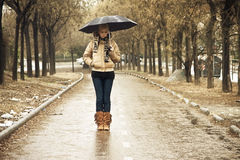 Young woman in walkway. Young blonde in walkway under rain Stock Photo
