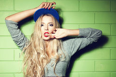 Young woman  in wall background Stock Images