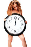 Young woman with a wall clock stock photography